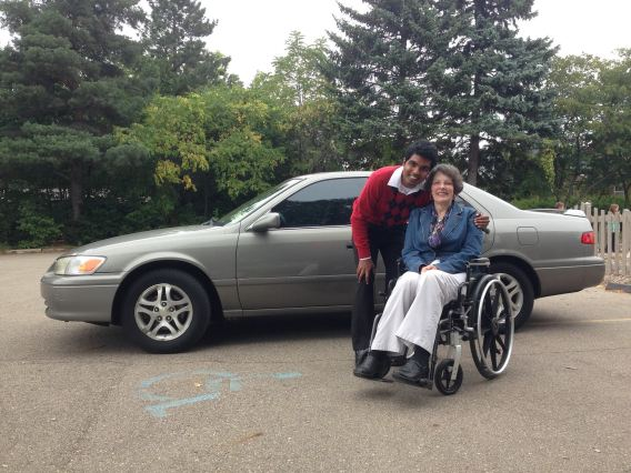Priscilla with the student and his car.